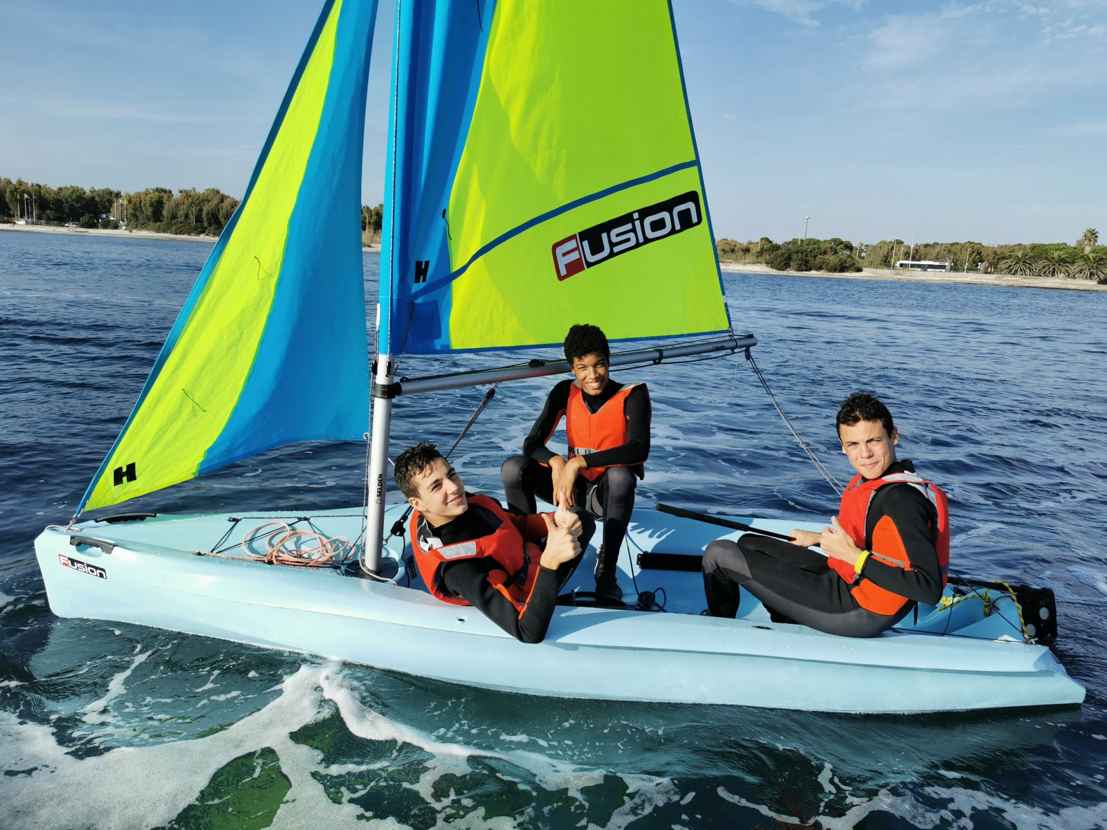 Boys trio sailing Sardinia Alghero teen summer camp Pintadera